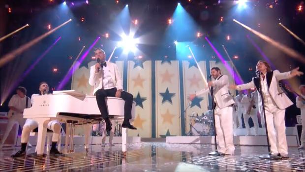 Robbie Williams weer met Take That op het podium