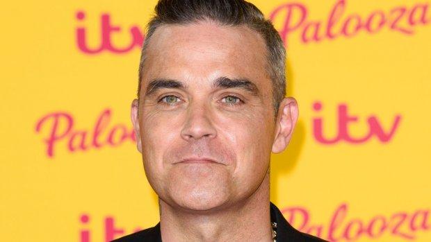 Robbie Williams heeft het aan de stok met buurman Jimmy Page