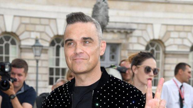 Robbie Williams spreekt een aardig moppie Nederlands