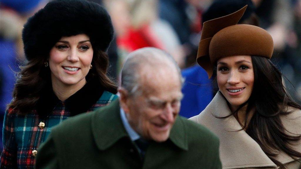 Catherine, prins Philip en Meghan Markle (vlnr)