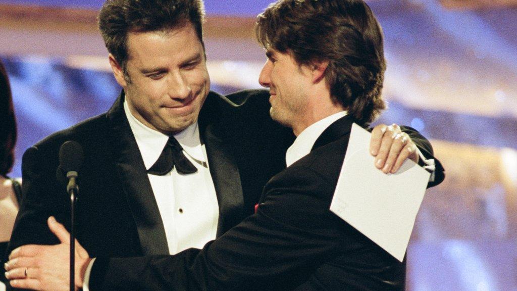 John Travolta en Tom Cruise in 1997